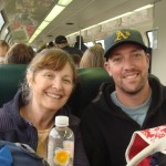 Maxine and Niall, out of the rain and on the train to the glacier.