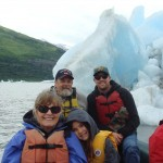 All of us on the raft in front of ice bergs.