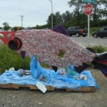 Funky salmon sign made from recycled soda bottles reflects the feeling of the area. I liked it.
