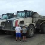 The boys in front of trucks on the beach in Ninilchik.