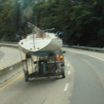 Crazy guy hauling a.. on Hiway 17 with that top-heavy boat behind him.