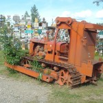 Tractor used to build Alcan in the weeds in the sign forest.