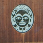 Nothing of the original buildings remain, but this is a decoration on the outside of a First Nation building through the window of the trolley.