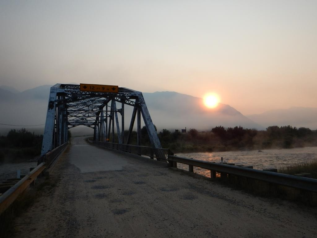 Smoky sunrise over the Madison River at 3 Dollar Bridge.